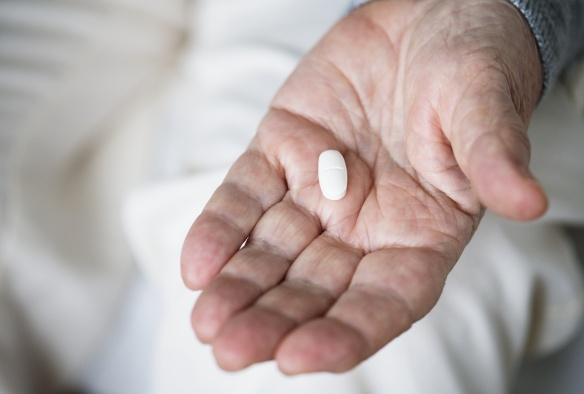 Elderly woman taking a medicine
