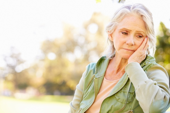 Depressed Senior Woman Sitting Outside
