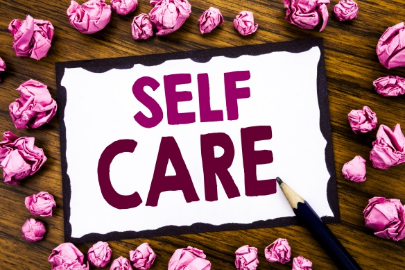 Hand writing text caption inspiration showing Self Care. Business concept for Taking caring for own Health Written on sticky note paper, wooden background with folded pink paper meaning thinking