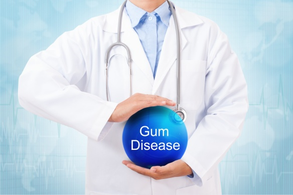 Doctor holding blue crystal ball with gum disease sign on medical background.