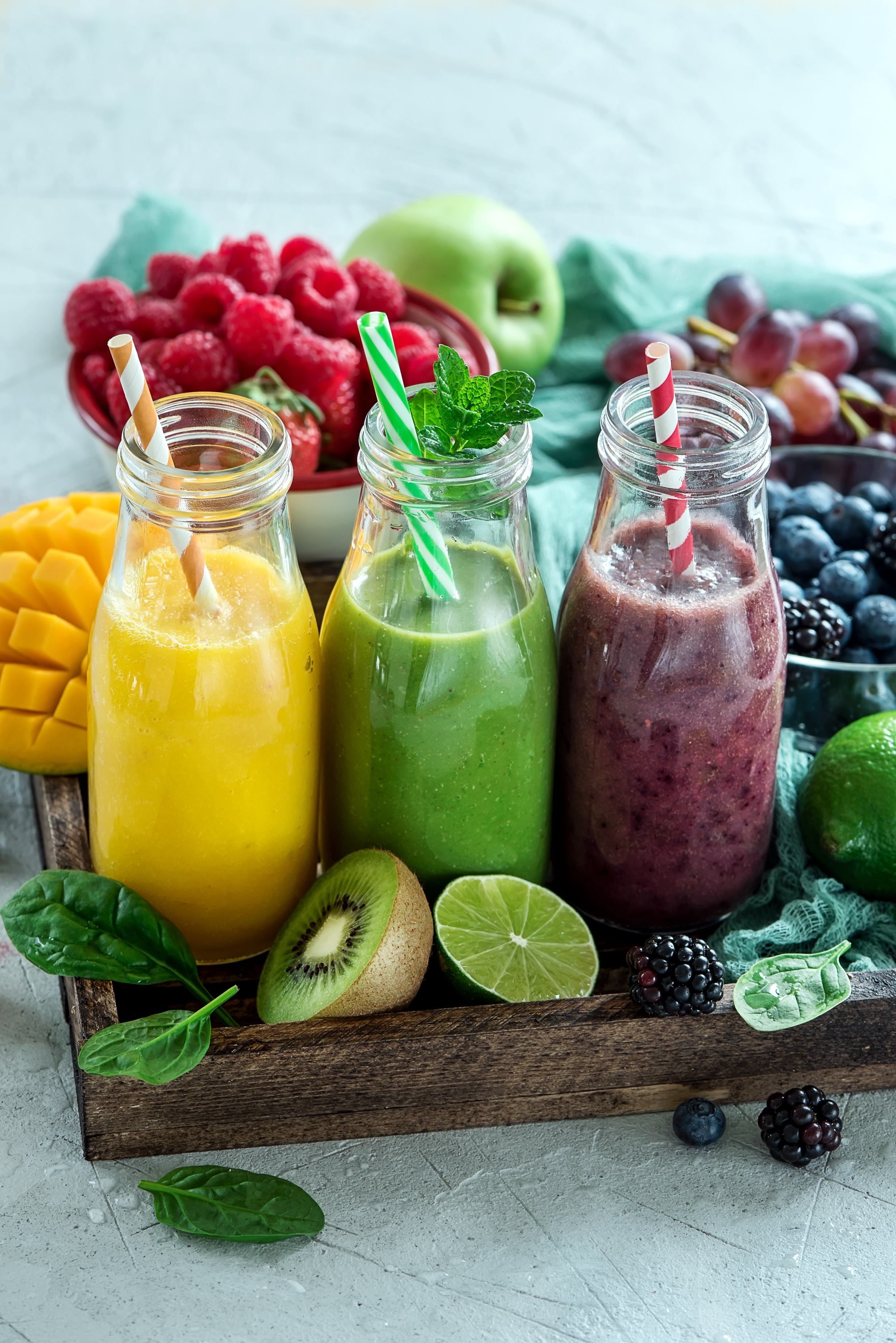 Colorful smoothies in bottles, detox summer diet fresh drink for breakfast or snack.